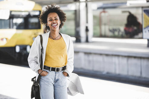 Laughing young woman at the train station - UUF20156