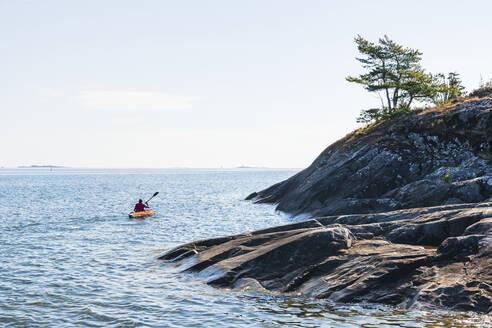Man kayaking on sea - JOHF05376