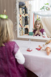 Little girl watching her mirror image while playing - PSIF00368