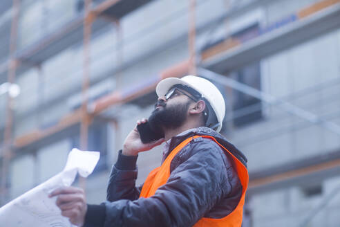 Construction engineer on the phone at construction site - SGF02580