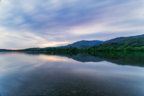 UK, England, Long exposure of clouds over Coniston Water lake at dusk - SMAF01712