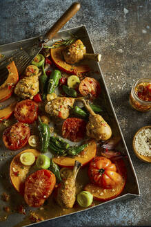 Tray with barbequed chicken legs and various vegetables - DREF00031