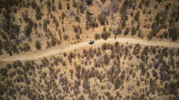 Aerial view of jeep on dirt track, Opuwo, Namibia - VEGF01412