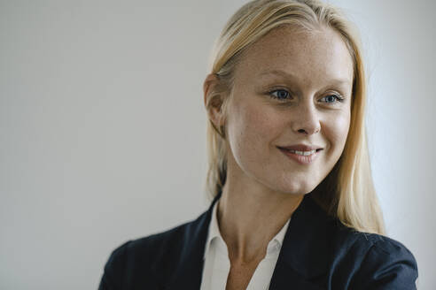 Portrait of a smiling blond young businesswoman - GUSF03320