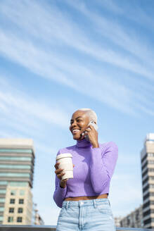 Portrait of white haired woman using smartphone and coffee to go - AFVF05037