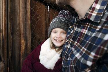 Portrait of smiling girl with her father outdoors in winter - EYAF00884