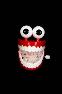 Studio shot of plastic toy dentures with sugar inside - AWDF00755