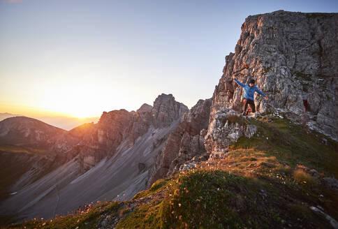 Mature man trai running on mountain ridge at Axame Lizum, Austria - CVF01521