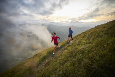 Man and woman running in the mountains - CVF01527