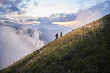 Man and woman running uphill in the mountains - CVF01530