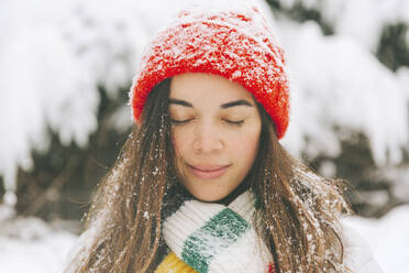 Portrait of smiling woman with eyes closed in winter - CMSF00076