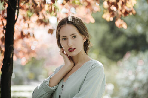 Portrait of young woman with red lips in nature - TCEF00067