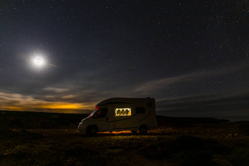Lighted camper parking under starry skay, Es Mercadal, Menorca, Spain - JPTF00455