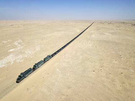 Mauritania, Nouadibou, Aerial view of cargo train riding through desert - VEGF01499