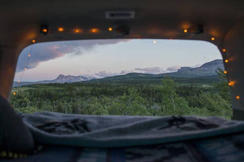 Scenic view of Glacier National Park seen through sports utility vehicle - CAVF73563