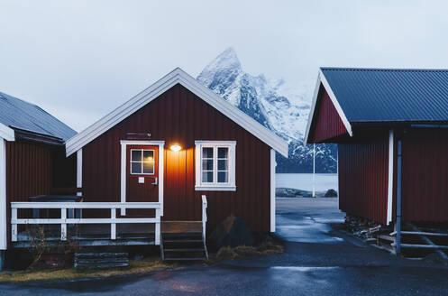 Illuminated red hut at the coast, Hamnoy, Lofoten, Norway - DGOF00068