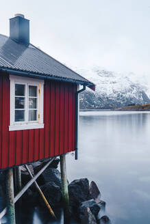 Red stilt hut at the coast, Hamnoy, Lofoten, Norway - DGOF00074