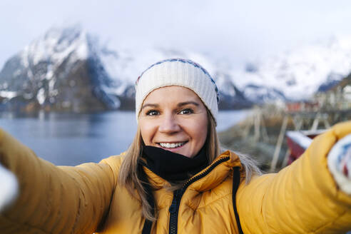 Selfie of smiling tourist at Hamnoy, Lofoten, Norway - DGOF00089