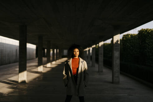 Young woman in a parking garage - TCEF00086