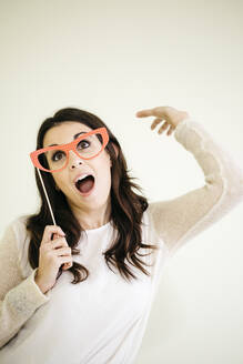 Portrait of playful young woman with comedy glasses - JRFF04084