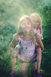Portrait of two girls celebrating Festival of Colours - SARF04450