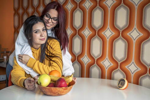 Portrait of two teenage girls at home - DLTSF00434
