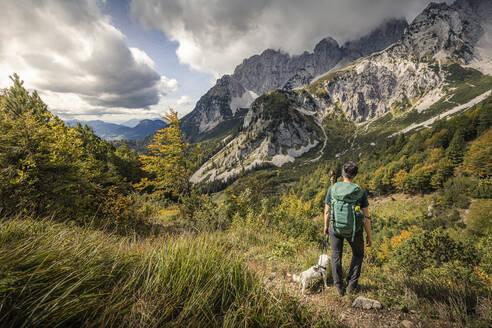 Woman on a hiking trip at Wilder Kaiser enjoying the view, Kaiser mountains, Tyrol, Austria - MSUF00167