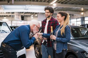 Couple buying new car at car dealership - MOEF02788