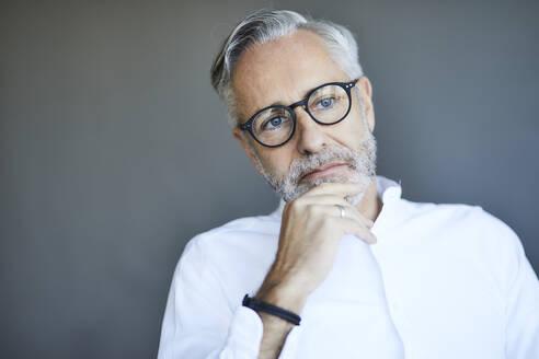 Portrait of mature man thinking - FMKF06132