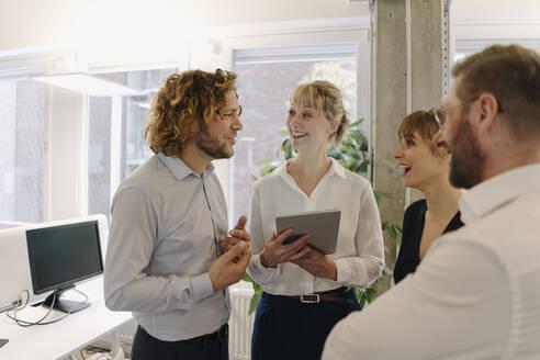 Happy bussiness team talking in office - KNSF07541