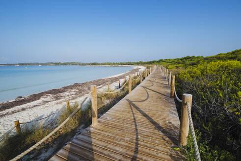 Wooden boardwalk on Son Saura beach, Menorca, Spain - RAEF02323