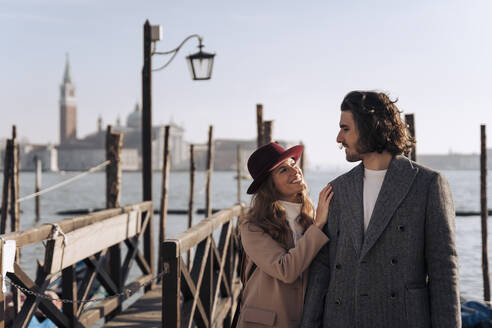 Young couple at the waterfront in Venice, Italy - MAUF03262