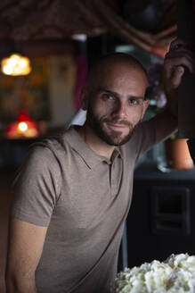 Portrait of smiling man in a bar - LJF01250