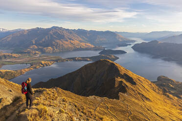 Woman standing on viewpoint at Roys Peak, Lake Wanaka, New Zealand - FOF11828
