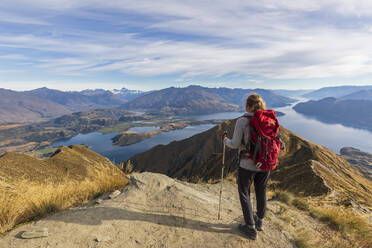 Woman standing on viewpoint at Roys Peak, looking to Mount Aspiring, Lake Wanaka, South Island, New Zealand - FOF11834