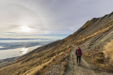 Woman hiking at Roys Peak, Lake Wanaka, New Zealand - FOF11840