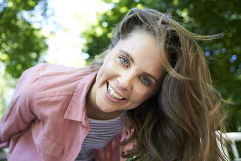 Portrait of happy brunette woman outdoors - PNEF02322
