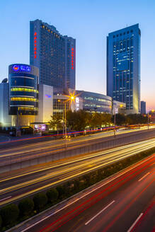 Traffic trail lights on major road near Beijing Zoo at dusk, Beijing, People's Republic of China, Asia - RHPLF13731