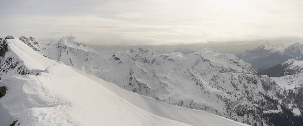 Panorama of high snowy mountain ridges, Lombardy, Valtellina, Italy - MCVF00218