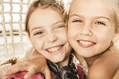 Portrait of two happy cute girls hugging - SDAHF00132