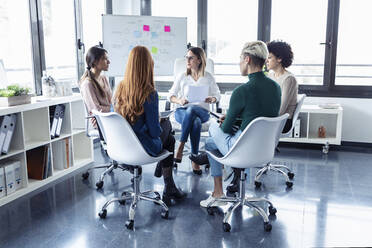 Businesswomen during meeting at a flipchart - JSRF00888
