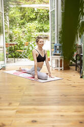 Young woman practicing yoga at home - PESF01774