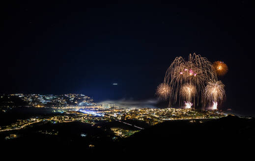 Spain, Granada, Almunecar, Illuminated city and fireworks at night  - LJF01302