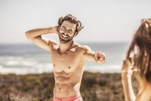 Portait of happy young man at the coast - SDAHF00190