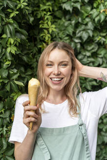 Portrait of happy young woman with ice cream cone - AFVF05432