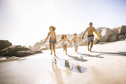 Happy family running on the beach - SDAHF00460