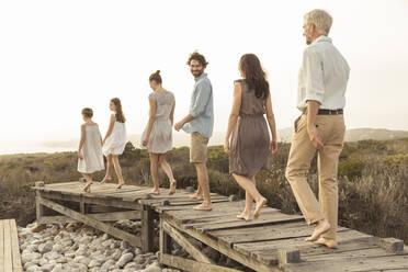 Large family enjoying the sunset on a boardwalk - SDAHF00475