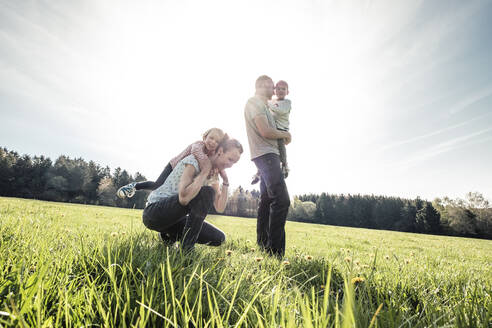 Happy family with two kids on a meadow in spring - WFF00272