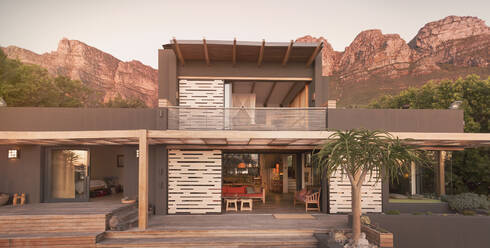 Mountains behind modern, luxury home showcase exterior house - HOXF04906