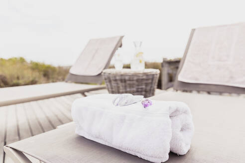 Towel on sun lounger at the poolside - SDAHF00534